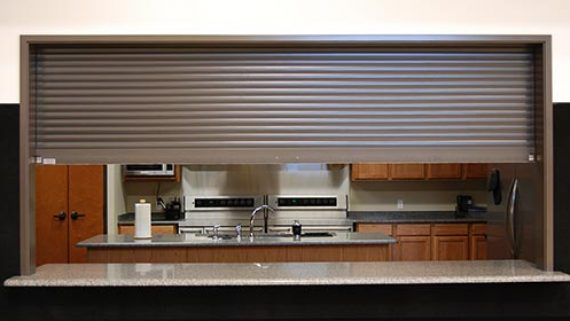 Security shutters and rolling doors rollok for Interior roll up security doors